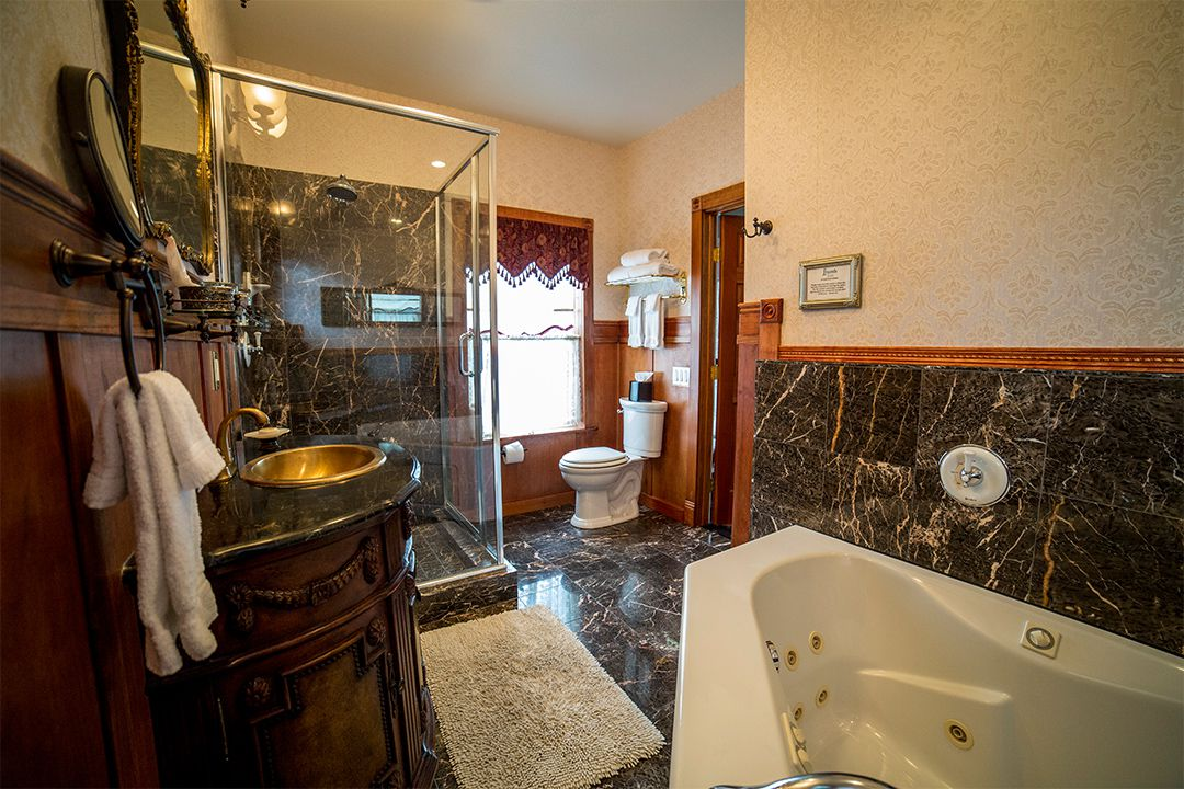 An Oversized Jacuzzi Tub & A Walk-in Shower in Demetria Master Bath